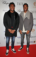 Alex Iwobi and Chuba Akpom at the Lux Afrique gala dinner, Claridge's Hotel, Brook Street, London, England, UK, on Sunday 01 October 2017.<br /> CAP/CAN<br /> &copy;CAN/Capital Pictures