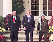 Israeli Prime Minister Binyamin Netanyahu, United States President Bill Clinton and Palestinian Authority Chairman Yasser Arafat walk through the Rose Garden at The White House in Washington, D.C. after their meeting on Thursday, October 15, 1998 prior to leaving for the Wye River Confrence Center..Credit: Ron Sachs / CNP