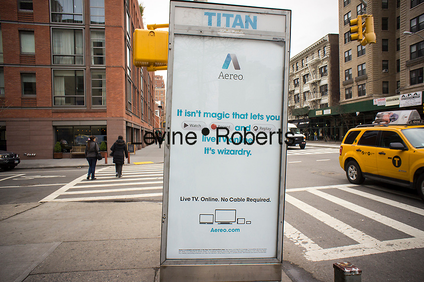 Advertising for the Aereo internet television service is seen on a telephone kiosk in the Chelsea neighborhood of New York on Thursday, April 11, 2013. Aereo is embroiled in lawsuits with broadcast television networks over retransmission fees related to their signals. (© Richard B. Levine)