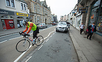 27 SEP 2013 - LISKEARD, GBR - Paul Parrish sets off again after stopping to talk with his support crew in the centre of Liskeard, Cornwall, Great Britain during the Enduroman 2013 Lands End to London to Dover ultra triathlon (PHOTO COPYRIGHT © 2013 NIGEL FARROW, ALL RIGHTS RESERVED)