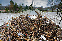 Pictured: Debris gathers on a footbridge leading over the river Taff in Pontypridd, Wales, UK. Sunday 16 February 2020<br /> Re: Storm Dennis has been affecting parts of Wales, UK.