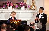 United States President Barack Obama applauds Governor Christine Gregoire, a Democrat from Washington, as she makes a toast at the start 2011 Governors Dinner at the White House in Washington, D.C., U.S., on Sunday, February 27, 2011. .Credit: Joshua Roberts / Pool via CNP
