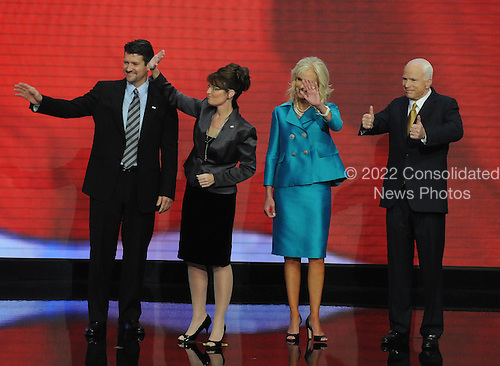 "St. Paul, MN - September 4, 2008 -- United States Senator John McCain (Republican of Arizona), right, flashes a ""thumbs-up"" after accepting his party's nomination as President of the United States on day 4 of the 2008 Republican National Convention at the Xcel Energy Center in St. Paul, Minnesota on Thursday, September 4, 2008.  From left to right: Todd Palin, Governor Sarah Palin of Alaska, Cindy McCain, John McCain.Credit: Ron Sachs / CNP.(RESTRICTION: NO New York or New Jersey Newspapers or newspapers within a 75 mile radius of New York City)"