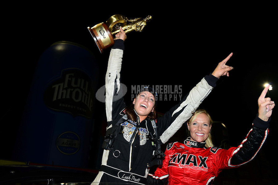 Sept. 16, 2012; Concord, NC, USA: NHRA pro mod driver Leah Pruett celebrates after winning the O'Reilly Auto Parts Nationals at zMax Dragway. Mandatory Credit: Mark J. Rebilas-