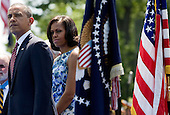 United States President Barack Obama and first lady Michelle Obama participate in a ceremony to commemorate the 50th anniversary of the Vietnam War at the Vietnam Veterans Memorial in Washington, D.C. on Monday, May 28, 2012. .Credit: Kristoffer Tripplaar  / Pool via CNP