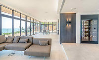 BNPS.co.uk (01202 558833)<br /> Pic: Strutt&Parker/BNPS<br /> <br /> Stunning views...<br /> <br /> A former WW2 battery, with unrivalled views across the channel to France, has come on the market - but you'll need deep pockets to shell out on its stunning location.<br /> <br /> The cliff top gun emplacement was rapidly constructed in 1940, as Britsh troops were fleeing Dunkirk, and has now been transformed into a £6million 'James Bond style' property.<br /> <br /> The Gunnery, near Kingsdown in Kent offers 'incredible' views of the Channel, with the iconic White Cliffs of Dover visible to the west, and France to the south, while also coming with six acres of sandy beach.<br /> <br /> The unique 82ft long property is accessed by an underground tunnel that leads through the cliff to a glass lift which travels up to it. Another secret tunnel inside the four bedroom home, which is just a few feet from the cliff edge, provides passage to a home cinema.<br /> <br /> The 50ft long living room has floor to ceiling windows and the original gun loops can still be seen.