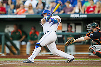 Florida Gators catcher Mike Rivera (4) swings the bat against the Miami Hurricanes in the NCAA College World Series on June 13, 2015 at TD Ameritrade Park in Omaha, Nebraska. Florida defeated Miami 15-3. (Andrew Woolley/Four Seam Images)