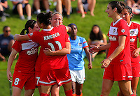 BOYDS, MD - May 26 2014: Christine Nairn is congratulated after scoring the winning goal during Washington Spirit v Houston Dash NWSL match at Maryland Sportsplex, in Boyds, Maryland. Spirit won 3-2.