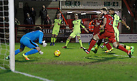 Exeter City's Jack Stacey watches his cross get claimed by Crawley Town's Glenn Morris during the Sky Bet League 2 match between Crawley Town and Exeter City at Broadfield Stadium, Crawley, England on 28 February 2017. Photo by Carlton Myrie / PRiME Media Images.