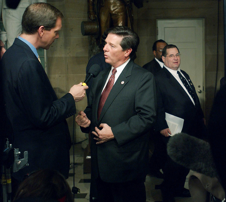 1/28/03.STATE OF THE UNION ADDRESS--Jerrold Nadler, D-N.Y., walks by House Majority Leader Tom DeLay, R-Texas, who is doing a television interview, in Statuary Hall after President George W. Bush's State of the Union address at the U.S. Capitol..CONGRESSIONAL QUARTERLY PHOTO BY SCOTT J. FERRELL