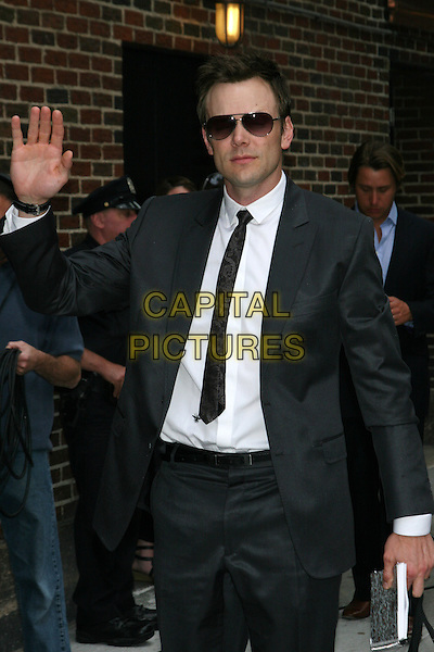 "JOEL McHALE (promoting fall sitcom 'Community').Taping of the ""Late Show with David Letterman"" at the Ed Sullivan Theater, New York, NY, USA..July 7th, 2009.half length black suit jacket tie white shirt sunglasses shades hand palm waving .CAP/LNC/TOM.©TOM/LNC/Capital Pictures."