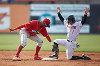 Tyler Frost (1) of the Kannapolis Intimidators keeps his foot on the bag as Lakewood BlueClaws second baseman Daniel Brito (21) holds the tag during the South Atlantic League game at Kannapolis Intimidators Stadium on April 8, 2018 in Kannapolis, North Carolina.  The Intimidators defeated the BlueClaws 4-3 in game two of a double-header.  (Brian Westerholt/Four Seam Images)