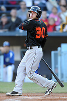Delmarva Shorebirds left fielder John Ruettiger #30 swings at a pitch during a game between the Delmarva Shorebirds and the Asheville Tourists at McCormick Field, Asheville, North Carolina April 6, 2012. The Shorebirds won the game 7-2  (Tony Farlow/Four Seam Images)..
