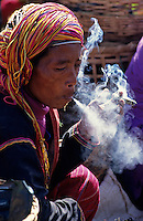 Images from the Book Journey Through Colour and Time, Hill tribe people in northern Burma, Myanmar smoking a very big local hand made cigar