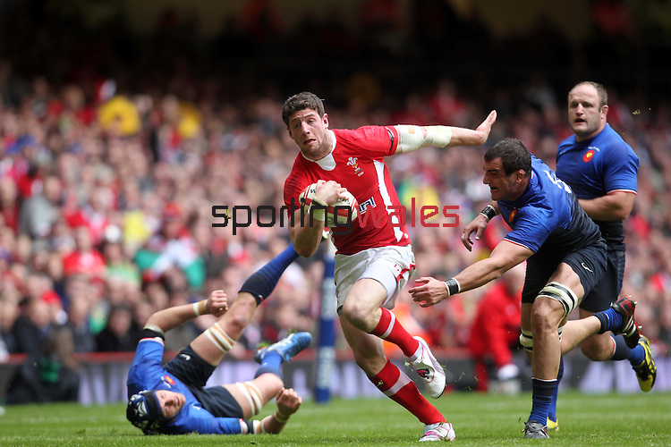 Alex Cuthbert splits the French defence on his way to scoring the first try of the match for Wales..RBS 6 Nations 2012.Wales v France.Millennium Stadium.17.03.12..CREDIT: STEVE POPE-SPORTINGWALES