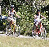 Michelle Obama trails Sasha Obama during a family bike ride in Manuel Correllus State Forest in West Tisbury, Massachusetts Friday, August 27, 2010. President Obama and daughter Malia followed within 30 seconds. .Credit: Vincent DeWitt - Pool via CNP