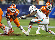 Charlotte, NC - December 2, 2017: Clemson Tigers running back Travis Etienne (9) avoids a tackle during the ACC championship game between Miami and Clemson at Bank of America Stadium in Charlotte, NC.  (Photo by Elliott Brown/Media Images International) Clemson defeated Miami 38-3 for their third consecutive championship title.