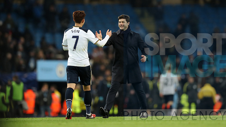 Son Heung-Min of Tottenham Hotspur and Tottenham Hotspur manager Mauricio Pochettino celebrate after the Premier League match at Etihad Stadium, Manchester. Picture date: January 21st, 2017.Photo credit should read: Lynne Cameron/Sportimage