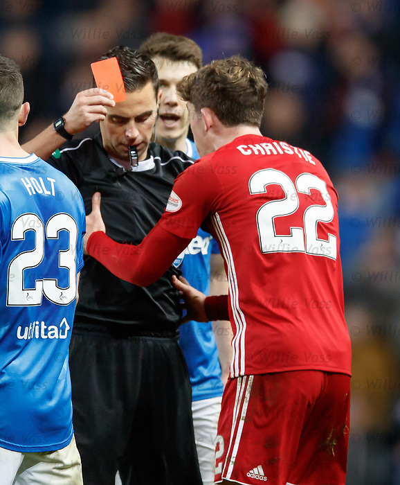 Andrew Dallas shows red to Ryan Christie