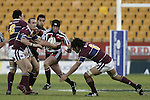 Blair Feeney goes past Hale T-Pole during the Air NZ Cup game between the Counties Manukau Steelers and Southland played at Mt Smart Stadium on 3rd September 2006. Counties Manukau won 29 - 8.