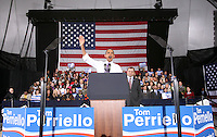 Oct 29, 2010. President Barack Obama, middle, waves to the crowd during a campaign rally for Virginia 5th District Representative Congressman Tom Perriello, right, Friday at the Charlottesville Pavilion in downtown Charlottesville, Va. Photo/Andrew Shurtleff