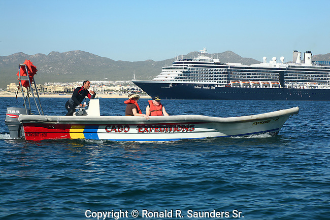 Elderly couple takes a slow boat ride on the Pacific Ocean. Cruise ship moored in the distance.