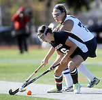 (Worcester Ma 111613) Longmeadow 16, Caroline O'Reilly, and Walpole 7, Brooke Matherson,  after the ball in the second half, Walpole High would go on to win  the MIAA Division 1 Field Hockey Championship against Longmeadow Highl, Saturday, November 16, 2013, at Worcester Polytechnic Institute in Worcester.  (Jim Michaud Photo)  for Sunday