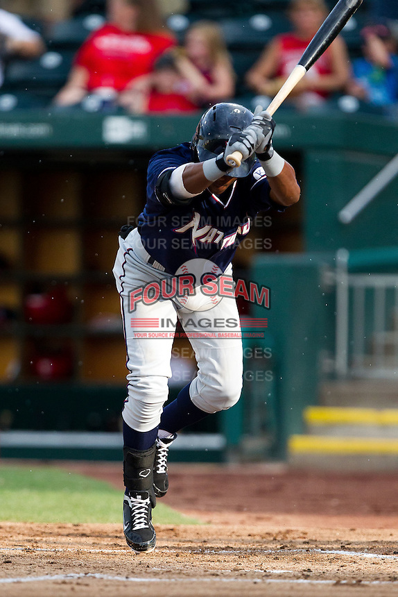 Rey Navarro (8) of the Northwest Arkansas Naturals dodges a wild pitch during a game against the Springfield Cardinals at Hammons Field on July 31, 2011 in Springfield, Missouri. Northwest Arkansas defeated Springfield 9-1. (David Welker / Four Seam Images)