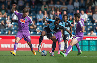Gozie Ugwu of Wycombe Wanderers takes on two Plymouth players during the Sky Bet League 2 match between Wycombe Wanderers and Plymouth Argyle at Adams Park, High Wycombe, England on 12 September 2015. Photo by Andy Rowland.