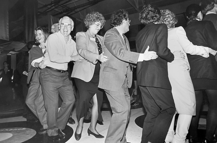 Congressmen dance a a sock hop event at Johns Hopkins University during the Democratic Issues Conference. Left to right: Robin Webb (Press Secretary to Foley) Rep. Victor Herbert Fazio, D-Calif., House Democratic Caucus Vice Chairman, Judy Kern Fazio, and Stan Greenberg. January 28, 1993 (Photo by CQ Roll Call)