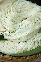 Lao Rice noodles are made from rice flour and water. However, sometimes other ingredients such as tapioca or corn starch are also added to improve the transparency or increase the chewy texture of the noodles. Rice noodles are most commonly used in the cuisines of East and Southeast Asia and are available fresh or dried, in various shapes and thicknesses.  Rice noodles freshly made tend to be far more tender with a distinctive texture.