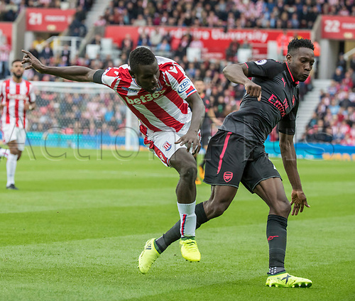 19th August 2017, bet365 Stadium, Stoke-on-Trent, England; EPL Premier League football, Stoke City versus Arsenal; Mame Biram Diouf of Stoke City makes a challenge on Danny Welbeck of Arsenal