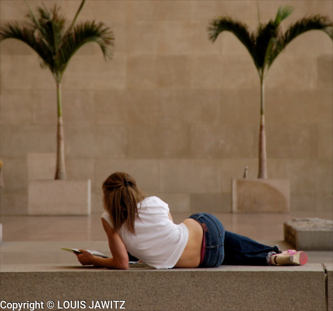 Resting ,Lying Down , Luxury  ,Resting , Day Dreaming , One Person, Serene People ,Horizontal,Hanging,out,Young Adult,