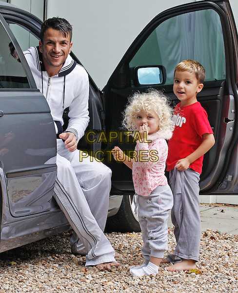 PETER ANDRE, PRINCESS TIAMII ANDRE & JUNIOR ANDRE.Spotted at his home in Brighton, West Sussex, England..September 13th, 2009.full length father dad daughter son family kids kids children sitting car grey gray tracksuit red pink.CAP/AFR.©Alan Fraser/Capital Pictures.