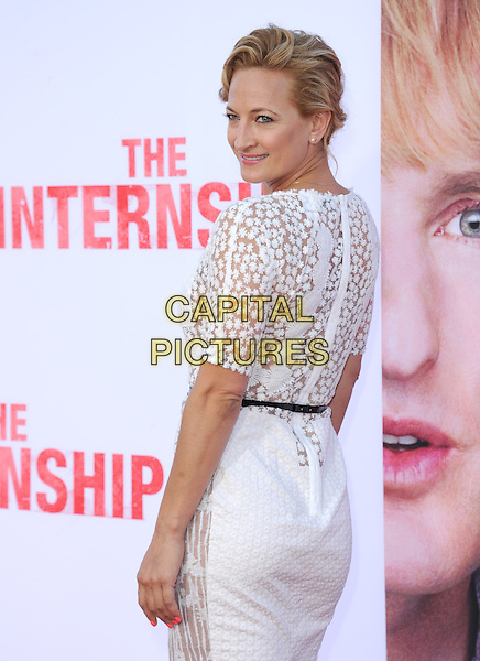 Zoe Bell<br /> &quot;The Internship&quot; Los Angeles Premiere held at the Regency Village Theatre, Westwood, California, USA.<br /> May 29th, 2013<br /> half length white lace dress black belt looking over shoulder back behind rear                                                     <br /> CAP/RKE/DVS<br /> &copy;DVS/RockinExposures/Capital Pictures