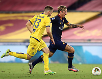 Football, Serie A: AS Roma - Hellas Verona Fc, Olympic stadium, Rome, July 15, 2020. <br /> Roma's Nicolò Zaniolo (r) in action with  Verona's Alan Empereur (r) during the Italian Serie A football match between Roma and Hellas Verona at Rome's Olympic stadium, on July 15, 2020. <br /> UPDATE IMAGES PRESS/Isabella Bonotto