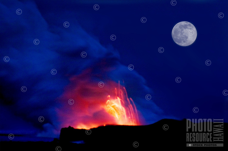Explosions and steam clouds under a full moon, where lava from the Big Island's Kilauea volcano reaches the Pacific Ocean.