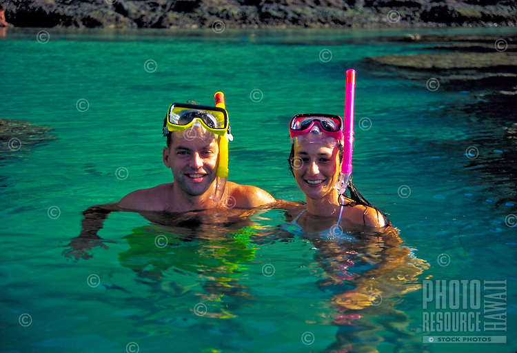 Couple w/ snorkels at Hanauma bay, Oahu