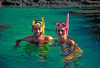 Couple w/ snorkels at Hanauma bay, Oahu