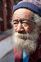 Bodhnath, Nepal.   Old Man Visiting the Buddhist Stupa of Bodhnath.