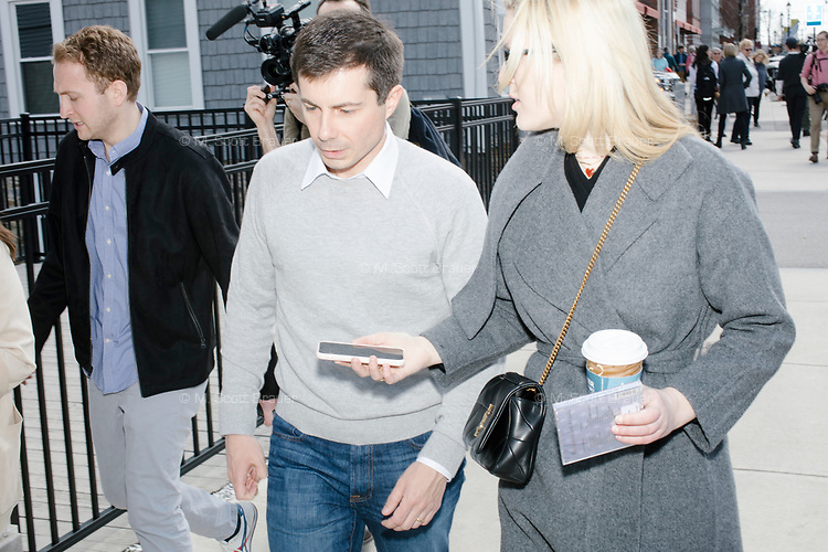 New York magazine Washington correspondent Olivia Nuzzi interviews Democratic presidential candidate Pete Buttigieg as they walk along South Main Street after speaking at a campaign event at Gibson's Bookstore in Concord, New Hampshire, USA, on Sat., Apr. 6, 2019. Buttigieg is the mayor of South Bend, Indiana, and was widely considered a long-shot candidate until his appearance in a CNN town hall in March 2019 which catapulted his campaign to prominence and substantial donations.
