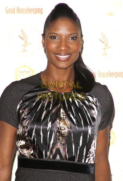 Denise Lewis.Women of the Year Awards at the Interconinental Hotel, Park Lane, London, England.October 22nd 2012.half length black top white print .CAP/ROS.©Steve Ross/Capital Pictures