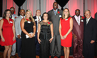 NWA Democrat-Gazette/CARIN SCHOPPMEYER<br /> <br /> Mona Rhodes Schreiber (from left), Gregory Lasker, Kendrick Moore, Tammy Kincaid Dustin, Slocum Pickell, Christin Wurth-Thomas, Oliver Miller, Gena Rhodes, Roddie Haley and Lou Holtz, the 2016 class of Razorback Foundation Sports Hall of Honors inductees, gather at the Hall of Honor banquet Sept. 2 at the John Q. Hammons Center in Rogers.