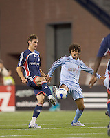 Colorado Rapids midfielder Mehdi Ballouchy (8) attempts to block a New England Revolution midfielder Andy Dorman (25) pass. The New England Revolution defeated the Colorado Rapids, 1-0, at Gillette Stadium in Foxboro, MA on September 29, 2007.