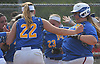 Christina Loeffler #45 of East Meadow, right, crosses home plate with celebrating teammates waiting after connecting for a solo home run in the bottom of the third inning of Game 3 of the Nassau County varsity softball Class AA final against Long Beach at Mitchel Athletic Complex on Friday, May 26, 2017. The homer extended the Jets' lead to 3-1. East Meadow went on to win by that same score to take the best-of-three series two games to one.
