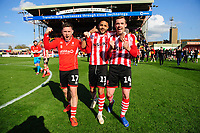 Lincoln City players, from left, Shay McCartan, Bruno Andrade, and Harry Toffolo, celebrate after securing promotion from Sky Bet League Two<br /> <br /> Photographer Chris Vaughan/CameraSport<br /> <br /> The EFL Sky Bet League Two - Lincoln City v Cheltenham Town - Saturday 13th April 2019 - Sincil Bank - Lincoln<br /> <br /> World Copyright &copy; 2019 CameraSport. All rights reserved. 43 Linden Ave. Countesthorpe. Leicester. England. LE8 5PG - Tel: +44 (0) 116 277 4147 - admin@camerasport.com - www.camerasport.com