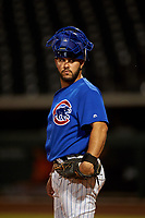 AZL Cubs 1 catcher Richard Nunez (5) warms up a relief pitcher between innings of an Arizona League game against the AZL Giants Orange on July 10, 2019 at Sloan Park in Mesa, Arizona. The AZL Giants Orange defeated the AZL Cubs 1 13-8. (Zachary Lucy/Four Seam Images)