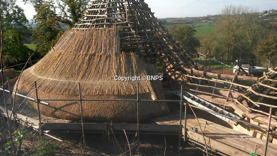 BNPS.co.uk (01202 558833)<br /> Pic: UpcottRoundhouse/BNPS<br /> <br /> Yabba-dabba-doo...<br /> <br /> Six tons of thatch.<br /> <br /> A farmer has painstakingly recreated an Iron Age roundhouse to enable holidaymakers to release their inner Flintstone in the heart of the Devon countryside.<br /> <br /> Charles Cole has gone back over 2000 years to offer a back to basic's experience including a stone hearth fire, rudimentary plumbing, composting toilet and a six ton thatched roof to keep out the wind and rain.<br /> <br /> The amazing structure has been completely hand built by Charles and his family from materials sourced from their own farm and they have just opened up for bookings at £170 a night.