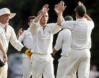 James Kidson (C - facing) is mobbed after taking the wicket of Sikander Randhawa during the Middlesex County Cricket League Division Two game between Harrow St Mary's and Shepherds Bush at<br /> Harrow on Sat July 19, 2014