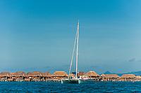 A catamaran with Four Seasons Resort Bora Bora in background, Bora Bora, French Polynesia.